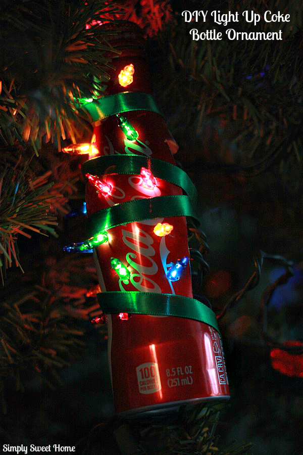 you have a fun and festive coca cola bottle christmas ornament that actually lights up how fun is that